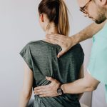 chiropractor-with-a-patient